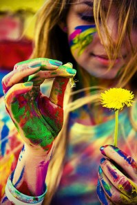 Colorful girl with dandelion